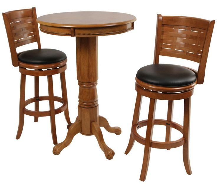 Oak 3 piece pub table set has a round sunburst wood veneer table top single pedestal column base and four legs of carved wood. 2 Swivel bar tavern style stools.