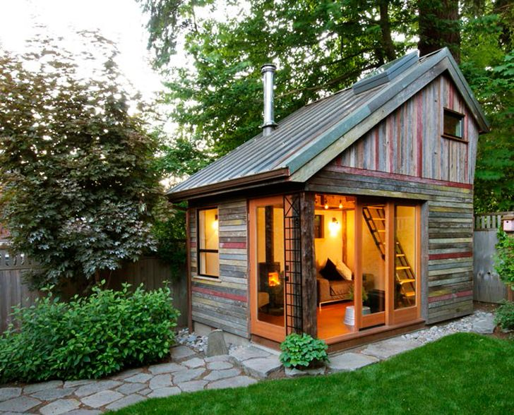 Tiny house in a garden... made from reclaimed barn wood. I would so have one of these as a guest space in my backyard.