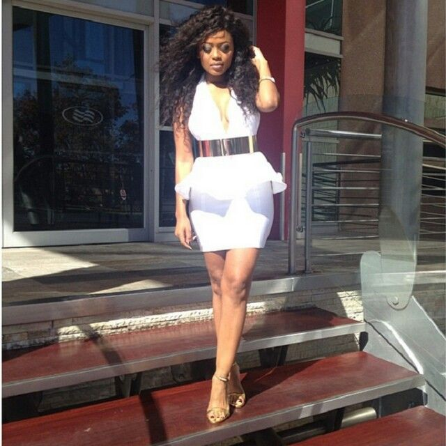 LERATO KGANYAGO  IN A WHITE PEPLUM AND GOLD HILLS