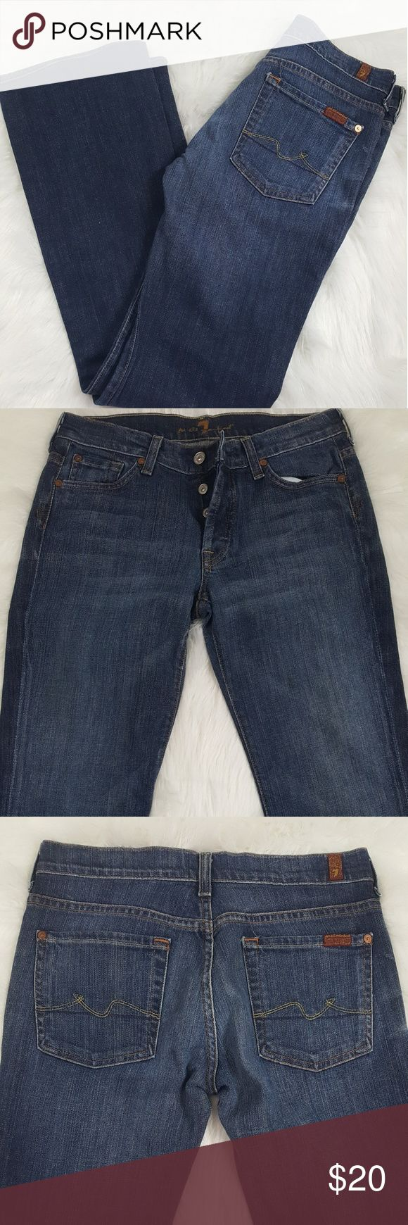 7 For All Mankind Women's Jeans Boy Cut Style 7 For All Mankind Jeans Boy Cut style with button up instead of zippers. Small stain on left knee. Not that visible. Otherwise great condition.  Measurements: Waist: 28 inches Inseam: 33 1/2 Hips: 19 inches Rise: 9 inches Cuffs: 9 inches 7 For All Mankind Jeans Boot Cut