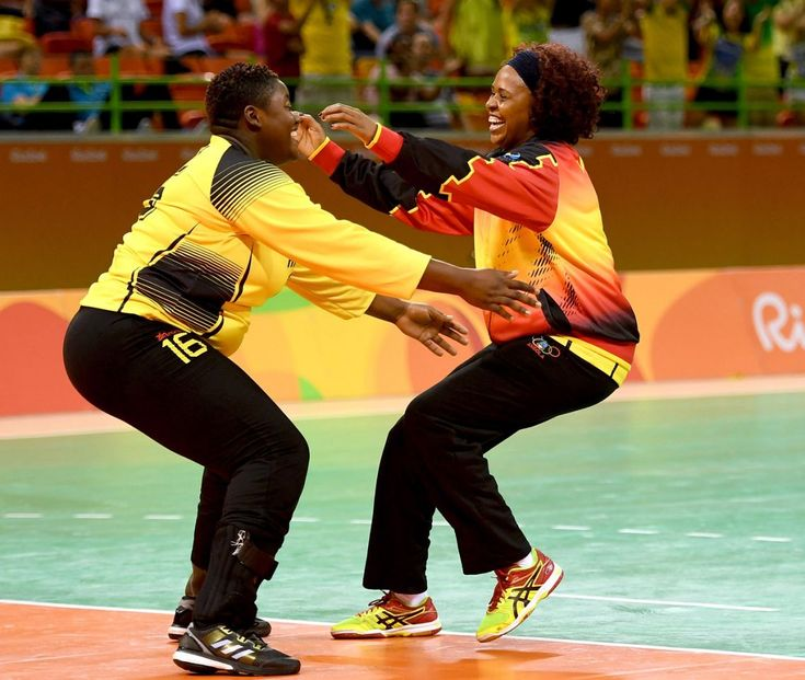 Teresa Patrica Alemida of Angola celebrates after the Women's Handball match between Romania and Angola on Day 1 of the Rio 2016 Olympic Games at Future Arena on August 6, 2016 in Rio de Janeiro, Brazil. (Photo by Ross Kinnaird/Getty Images)