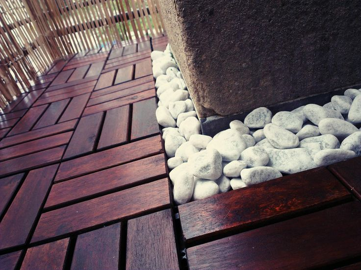 wooden floor tiling for outdoors with stone in areas where tiling didn't fit perfectly