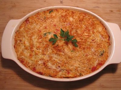 Giada's recipe for baked pastina with tomatoes and chicken.