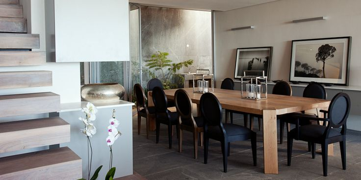 Pierre Cronje Quattro dining table and Sandton chairs in this Camps Bay Beach Villa in Cape Town