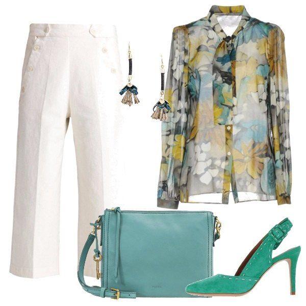 Il gusto per la moda italiano si riconosce dei dettagli, come i bottoni nei pantaloni al polpaccio, il fiocco della colorata camicia, le impunture delle sling back, i particolari dorati della borsa e gli orecchini pendenti.