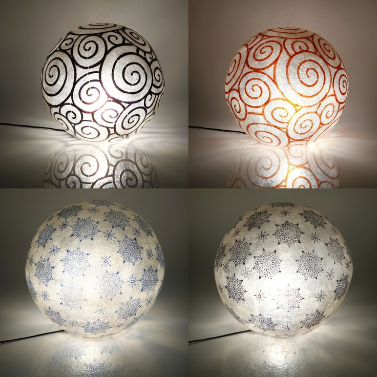 ''Spiral'' and ''Lace'' fiberglass balls.   Handmade fiberglass ball lamps.  Fiberglass material is robust and lightweight  It can be hang from the ceiling as the central light of the space, or be put on the floor/any surface as a floor/desk lamp.The balls have Natural White as its background color.