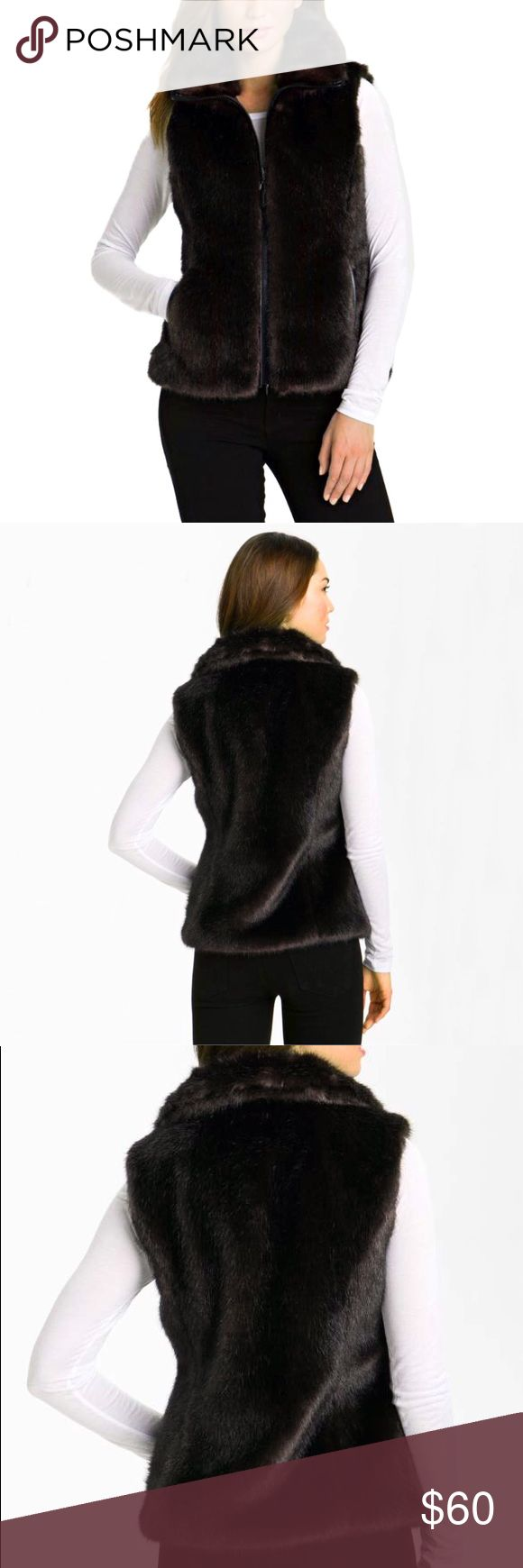 🆕 Reversible Faux Mink Fur Vest 🆕 NWOT • Glossy faux mink fur covers one side a collared vest, while a polyester shell defines the reverse side. Faux leather piping trims the zippered placket on the faux fur side. Both sides have pockets. The faux fur collar is visible on the reverse side. Collar stands high when zipped all the way. 🔹Style tags: Glossy, luxurious, stylish, cozy, deep chocolate color. Gallery Jackets & Coats Vests