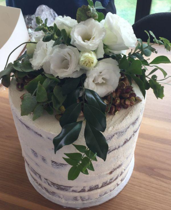 Naked Cake  White Chocolate Mud Cake Vanilla Bean Buttercream Honey coated pistachio nuts Flower arrangement