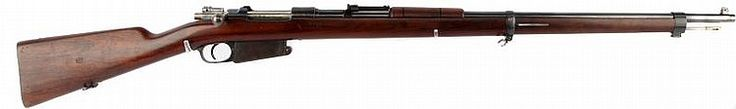 Argentine Mauser Model 1891 rifle, manufactured by Lowe, Berlin. Matching serial numbers on barrel, receiver, bolt, stock, and floor plate of magazine. (My son sold his just a few months ago) Beautiful rifle for a collector, but not great for practical use (i.e. cost & attainability of ammo). Fun to shoot if you have the strength ;)