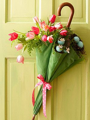 Use a child size umbrella, fill with moss or something soft, then glue in  the little eggs and fill will flowers..neat