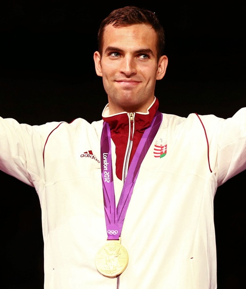 Gold medalist Aron Szilagyi of Hungary poses on the podium during the medal ceremony for the Men's Sabre Individual