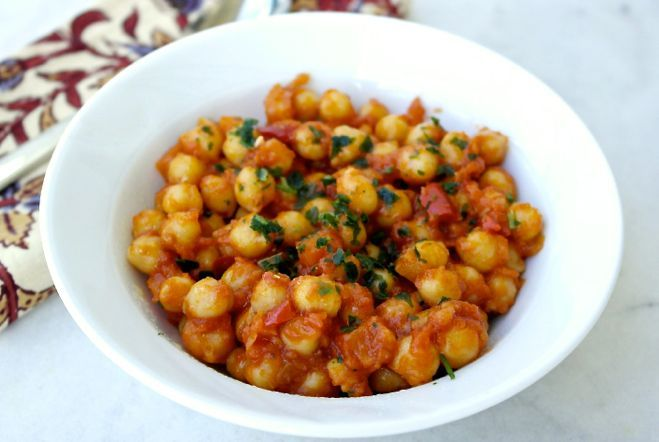 Chickpeas cooked in tomato sauce , a delicious protein and fiber rich dish.