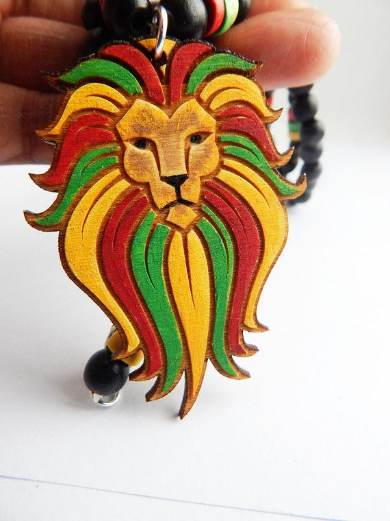 African Rasta Lion Mens Necklace A wood Lion pendant beaded necklace. The piece is designed by The Blacker The Berry. There are two pendant size options. The small is show in the pictures. The small pendant is 2 inches wide and 2 1\2 inches long. The large pendant is 2 1/4 in wide and 3 1/4 in long. The 30 inch has yellow, green, red and black wood beaded necklace. The necklace closes with a lobster clasp. If you have any questions about this piece please feel free to contact me at...