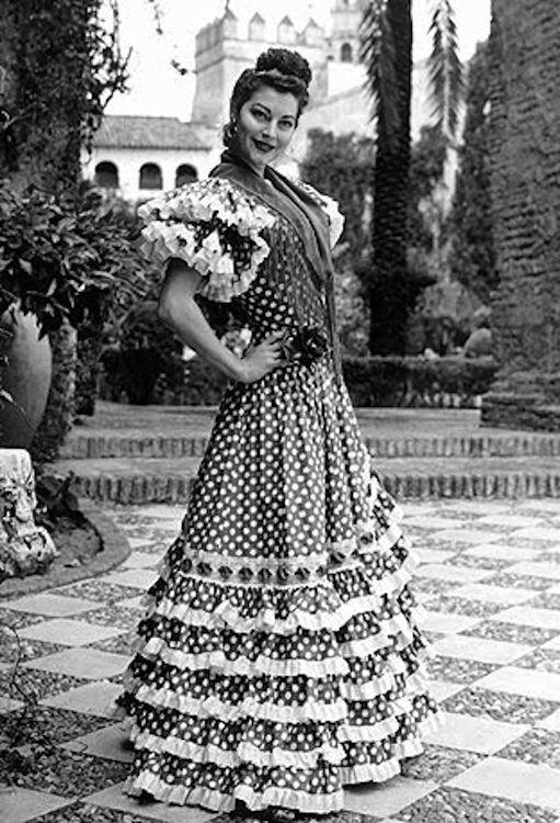 Ava Gardner wearing a flamenco dress in The Alhambra, Granada.