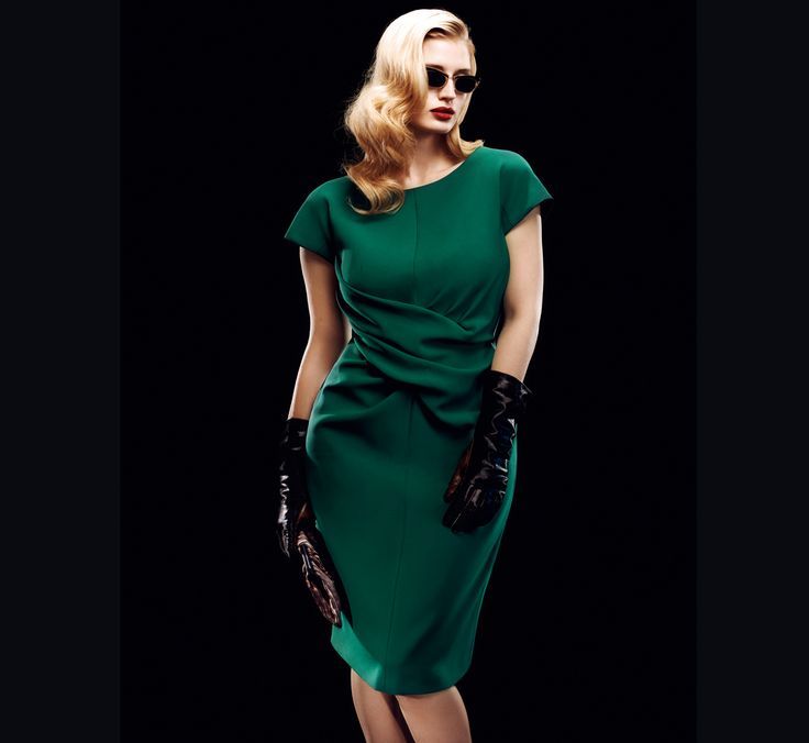 Dark green cap-sleeve dress with cross-over gathering at the waists. Worn with animal print clutch and deep brown nappa leather gauntlet gloves.