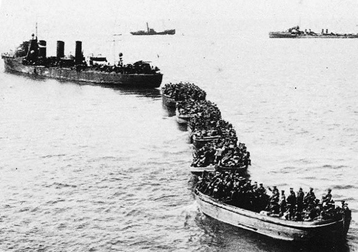 Gallipoli - Landings in rows of open-topped boats towed behind steamers. Cut loose near the shore, the men used oars the rest of the way