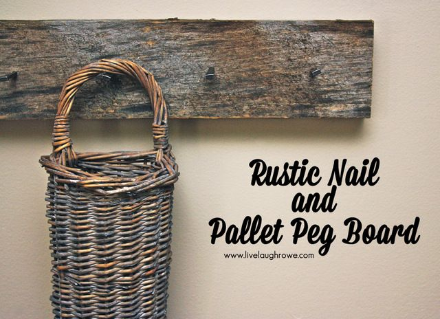 Rustic Nail and Pallet Peg Board.  Easy pallet project that consists of masonry hard cut nails and pallet board. Perfectly rustic!