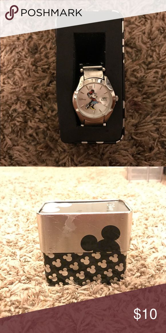 Minnie Mouse watch A cute little vintage Minnie Mouse watch! She comes in a cute little Disney container and is a very cute accessory! It has never been worn Disney Accessories Watches