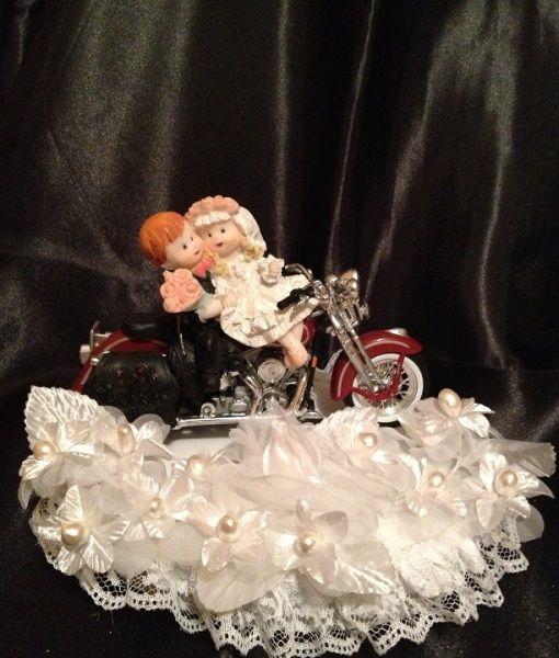 click here for you unique wedding cake topper http://uniqueweddingcreations.com/