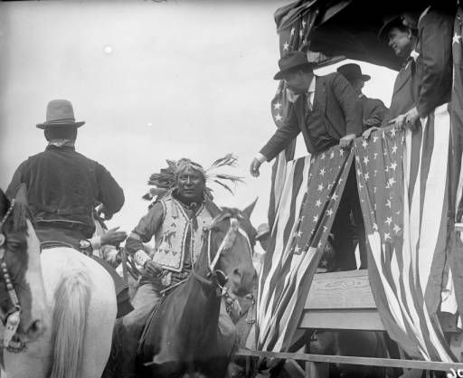 President Theodore Roosevelt greeting an Indian Chief after his speech in Glenwood Springs :: Western
