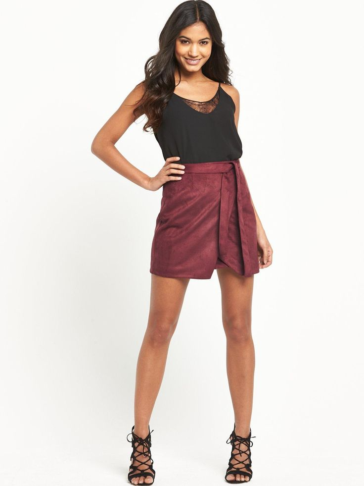 This side wrap mini skirt by River Island is a power player in your trans-seasonal wardrobe. Team this skirt with tights and ankle boots on breezy days, or sandals and bare legs when the weather warms.