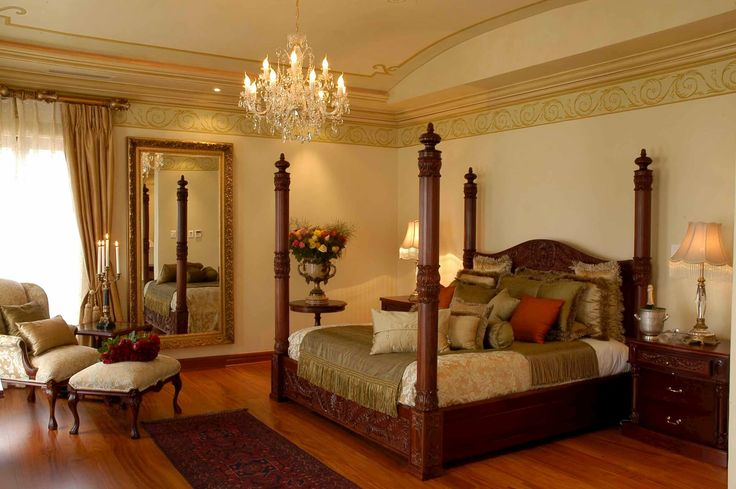 A contemporary home in Johannesburg, inspired by Classical Italian interior design and decoration. Sumptuous use of rich fabrics. Creative paint techniques. Impressive chandeliers. Bedroom with beautiful classical furniture.