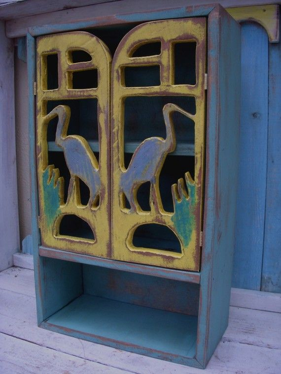 blue heron doors; these would be great adapted for a gate to enter an area with a pond.