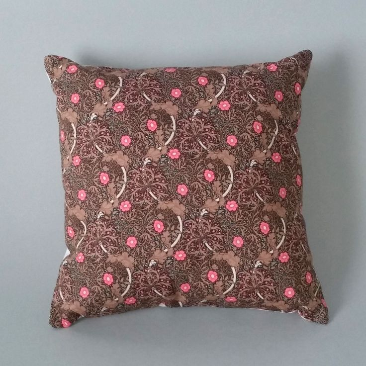 Our 'Woodland' cushion combines fabric with a lovely contemporary woodland scene with beautiful William Morris style fabric with a brown floral print pattern