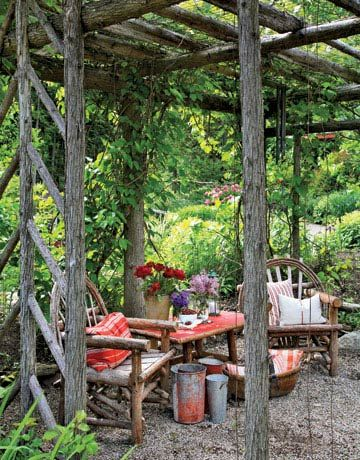 The rustic cedar pergola — planted with climbing roses, golden hops vine, hardy kiwi, and grapes — offers a shady, scenic spot to rest and enjoy the views, scents, and sounds of the garden.