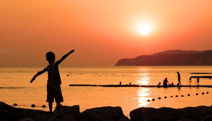 Silhouette of child against sunset by windu on Creative Market