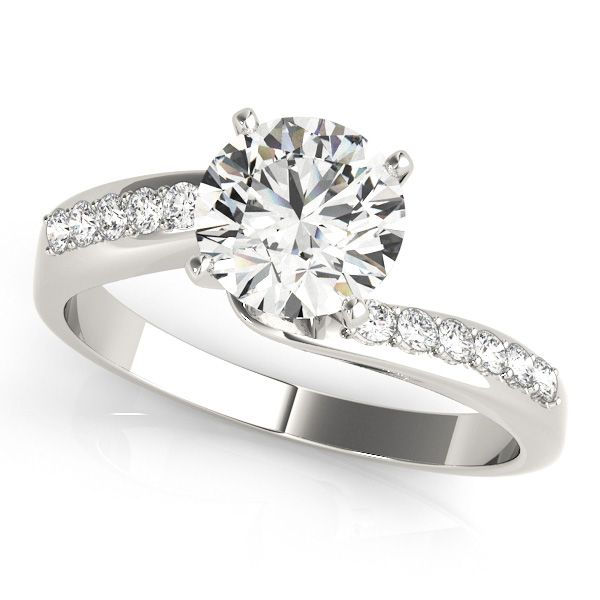 The Beautiful Round Ged Diamond Is Highlighted By Pave Set Smaller Stones On This Byp Style Ring Made Of White Gold