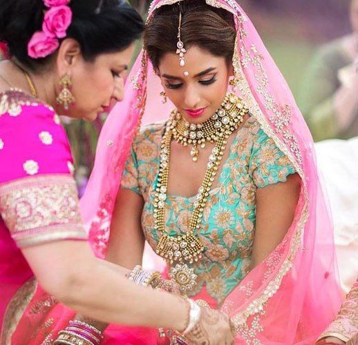 Bride in a pink and blue lehenga |  Bridal lehengas colours perfect for the Indian skin tone | Indian Wedding jewellery inspiration | Mother of bride | bridal fashion | Bridal couture | Courtesy: Pinterest | Every Indian bride's Fav. Wedding E-magazine to read.Here for any marriage advice you need | www.wittyvows.com shares things no one tells brides, covers real weddings, ideas, inspirations, design trends and the right vendors, candid photographers etc.