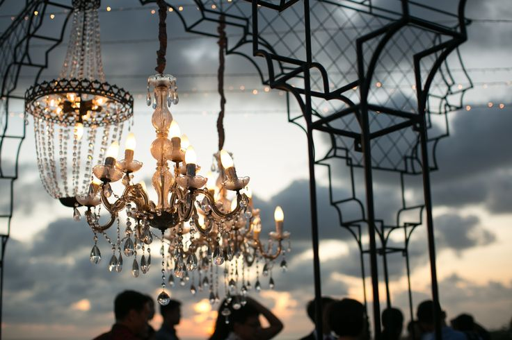 Cocktails in Dusk with Chandeliers lit up