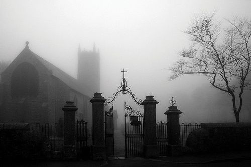 A thick fog blankets this beautiful building.