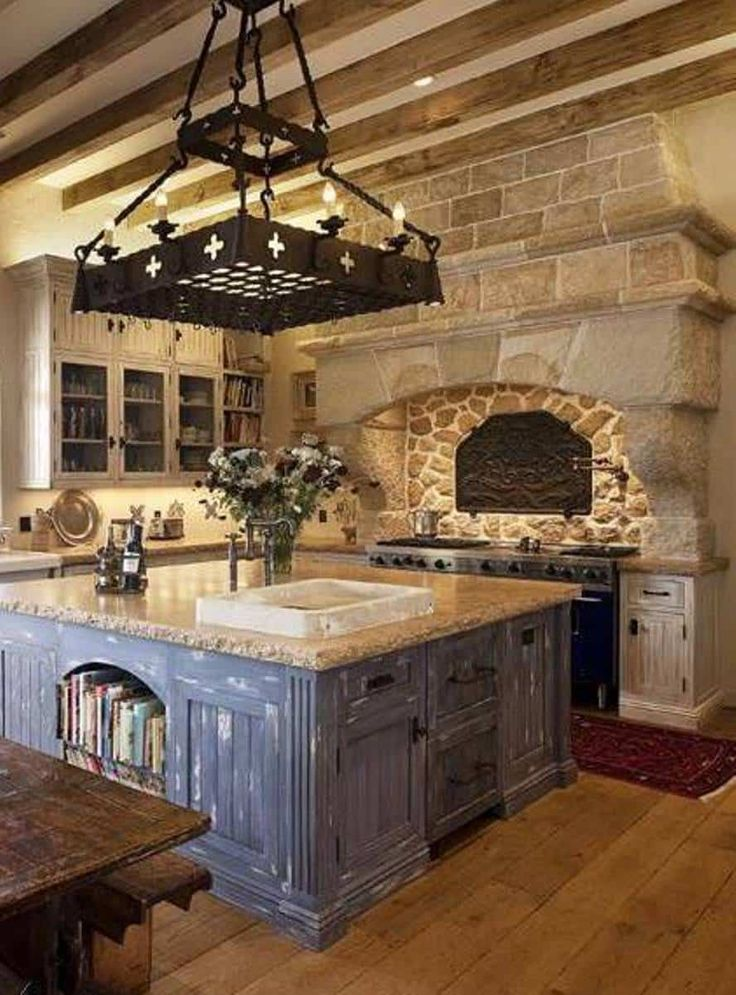 Kitchen , Old World Kitchen Room Style : Old World Kitchen Room Style With Beams And Large Hood With Stone Walls Over Range And Pot Filler And Chandelier With Pot Rack Over Island With Bookcase