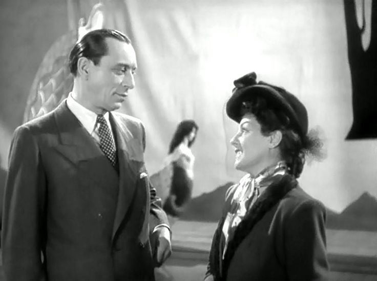 Louis Jouvet and Gaby Morlay in Un Revenant (1946) Directed by Christian-Jaque