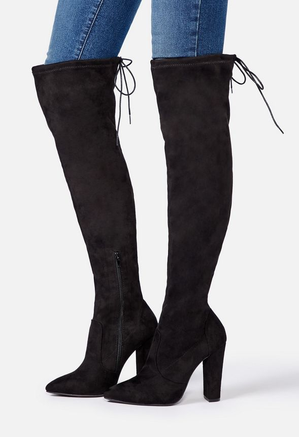 A sexy and flattering over-the-knee boot featuring a drawstring back detail to prevent slipping, a covered block heel, and an inner zip closure....