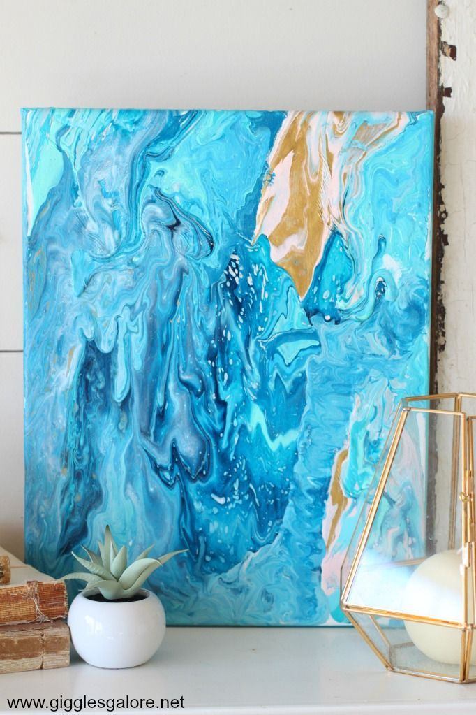 Create your own trendy fluid acrylic poured canvas art.
