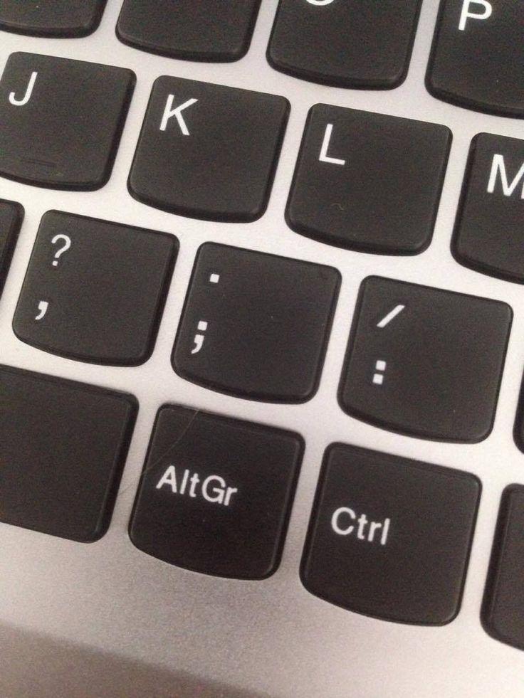 Punt= Dit is het toetsenbord van mijn computer waar u een punt op ziet.
