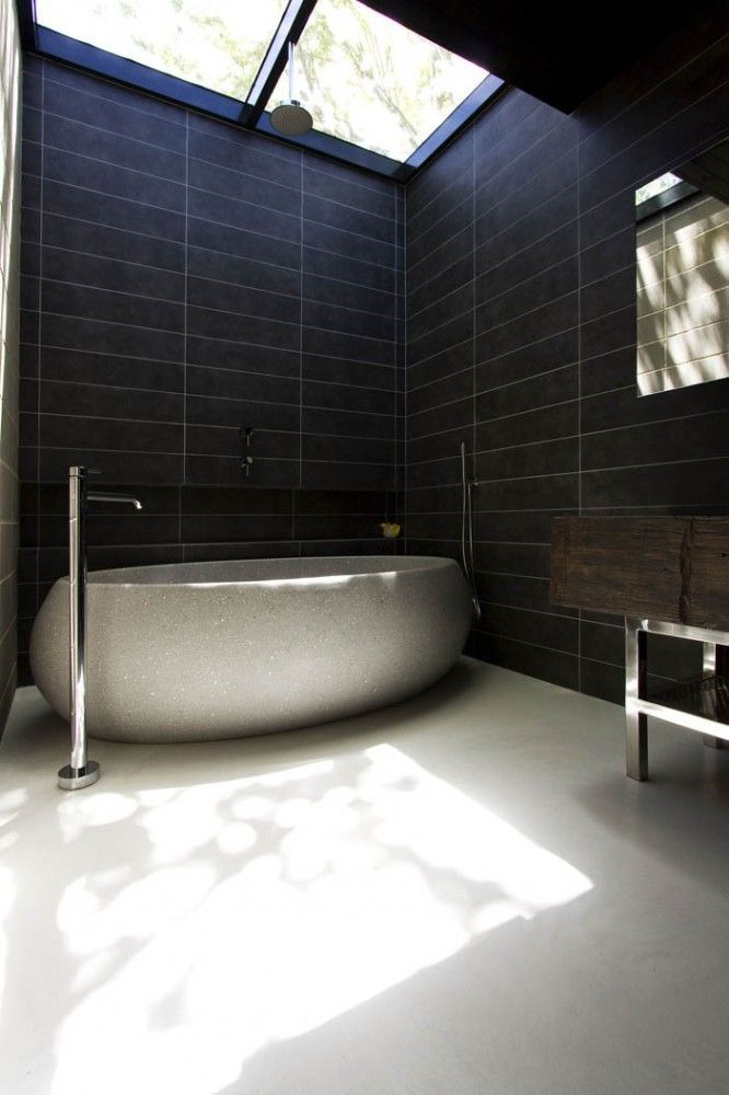 Really like the dark wall tile and the design of the tub. Definitely a unique look.