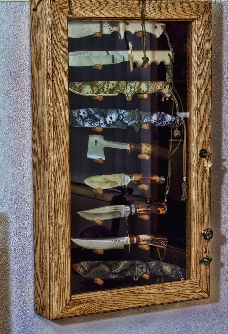 Man Cave Knife cabinet http://www.mancavegenius.org/category/man-cave-design/