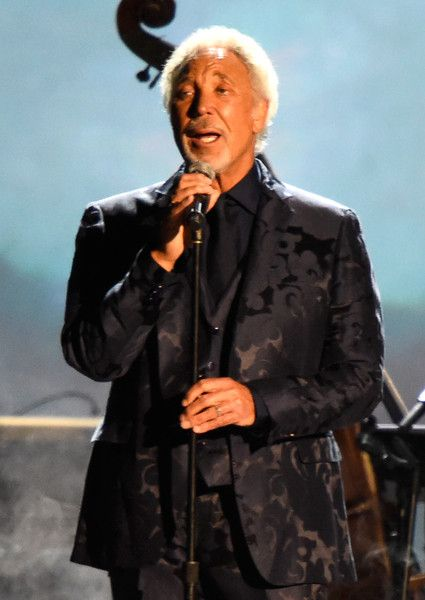 Tom Jones Photos Photos - Singer Tom Jones performs onstage at the 25th anniversary MusiCares 2015 Person Of The Year Gala honoring Bob Dylan at the Los Angeles Convention Center on February 6, 2015 in Los Angeles, California. The annual benefit raises critical funds for MusiCares' Emergency Financial Assistance and Addiction Recovery programs. - The 2015 MusiCares Person Of The Year Gala Honoring Bob Dylan - Show
