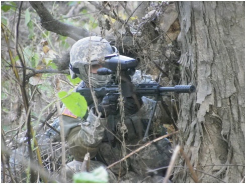 Cadet returning fire during squad attack.