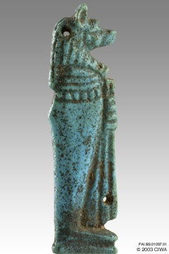"This sapphire blue faience amulet of protection represents the god Duamutef, the jackal-headed Son of Horus, guardian of the stomach, holding a long folded cloth. Dynasty 25.    ""During the Third Intermediate Period, mummification practices changed and the packages containing the embalmed internal organs were no longer placed in Canopic Jars but were returned to the body cavity, each with an amuletic figure of the relevant deity attached"" (Andrews 1994:45-46)."