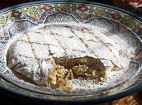 Bastilla - traditional Moroccan recipe for bread stuffed with saffron chicken and toasted almonds.
