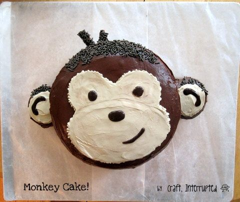 "Monkey Party - Food Table & Monkey Cake ""  This was two 8"" rounds and 2 cupcakes for the ears.  I sliced a half inch or so off the edge of each cupcake to make a flat side, and attached that with icing to the sides of the face part, which I had already covered with chocolate icing."" Instructions at site."