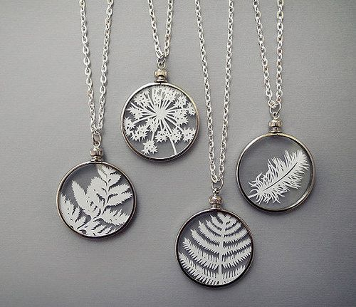 Sarah Trumbauer often turns her work into wearable art. These elegant, nature-inspired necklaces feature tiny (just i inch!) hand cut designs that float between two micro-thin layers of glass.