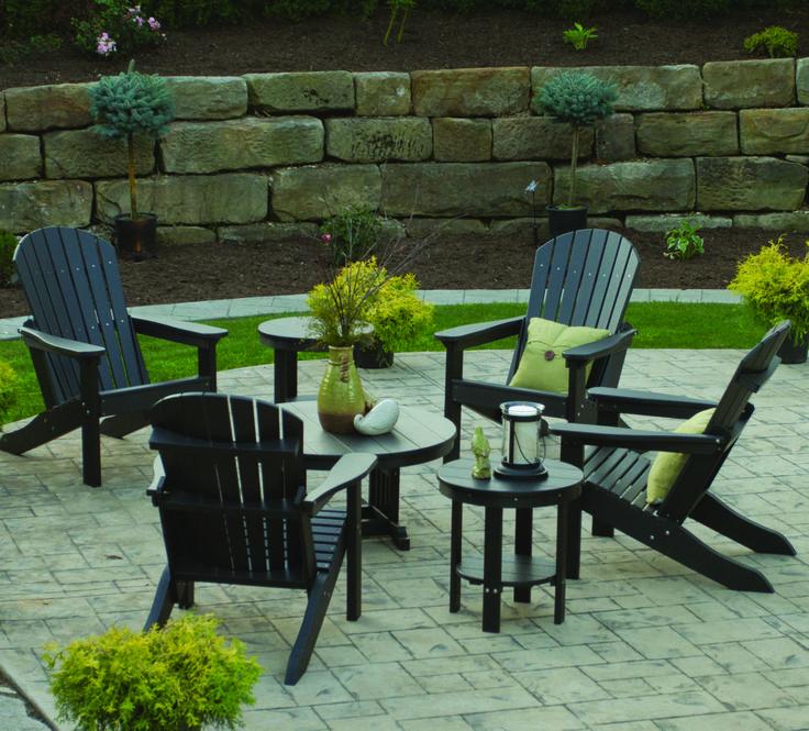Adirondack chairs gathered around a coffee table creates a popular hangout spot in any backyard. #adirondackchairs #backyard #relax #BerlinGardens