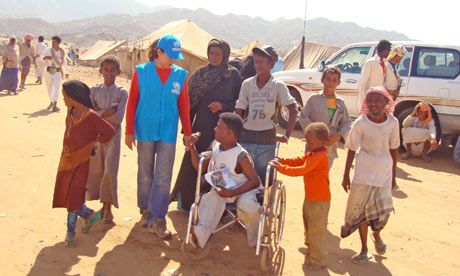 #1) The name of my dream job is called an International Aid Worker.Here you can see a international aid worker (blue vest) helping children and people from all around the world.