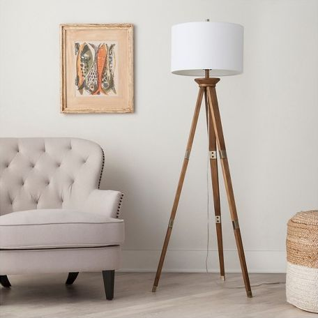 A unique tripod lamp to illuminate your space. | 31 Home Decor Products You Didn't Know You Could Get At Target